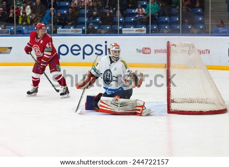 MOSCOW - JANUARY 10, 2015: Goalkeeper Mark Owuya (34) on a gate in action on hockey game Vityaz vs Medvezchak on Russian KHL premier hockey league Championship in Moscow, Russia. Medvezcak won 3:2 - stock photo