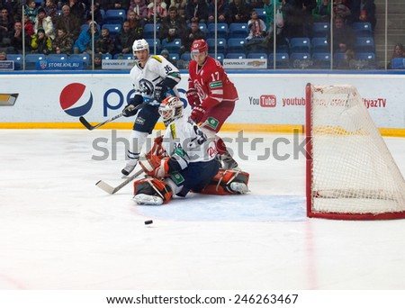 MOSCOW - JANUARY 10, 2015: Goalkeeper  on a gate in action on hockey game Vityaz vs Medvezchak on Russian KHL premier hockey league Championship on January 10, 20in Moscow, Russia. Medvezcak won 3:2 - stock photo