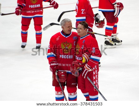 MOSCOW - JANUARY 29, 2016: V. Fetisov (2) and P. Bure (10) just after hockey game Finland vs Russia on League of World legends of Ice hockey championship in VTB ice arena, Russia. Russia won 6:2 - stock photo