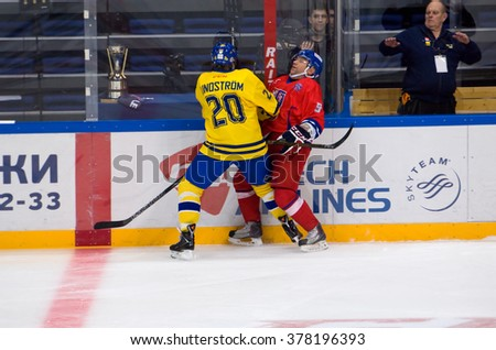 MOSCOW - JANUARY 29, 2016: W. Lindstrom (20) attack J. Reznicek (9) during hockey game Sweden vs Czech on League of World legends of Ice hockey championship in VTB ice arena, Russia. Czech won 8:2 - stock photo