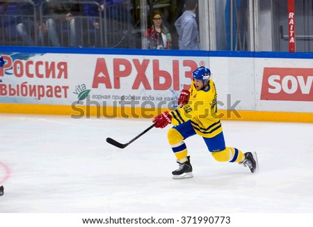 MOSCOW - JANUARY 29, 2016: Willy Lindstrom (20) shot during hockey game Sweden vs Czech on League of World legends of Ice hockey championship in VTB ice arena, Russia. Czech won 8:2 - stock photo