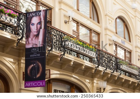 MOSCOW - JULY 29: Balcony and advertising poster in GUM store on July 29, 2014 in Moscow. GUM is the large store in the Kitai-gorod part of Moscow facing Red Square. - stock photo