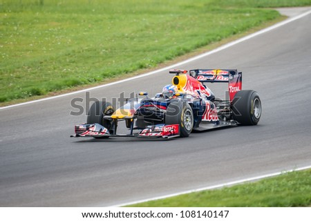 """MOSCOW - JULY 14: Daniel Ricciardo F1 driver of Scuderia Toro Rosso in formula 1 car Red Bull RB6 at opening new circuit """"Moscow Raceway"""" July 14, 2012 in around Moscow, Russia - stock photo"""