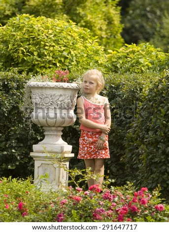 MOSCOW - JULY 15, 2014: girl in rosarium in park Sokolniki, park founded in 1878 in hunting area of Russian kings near Moscow. - stock photo