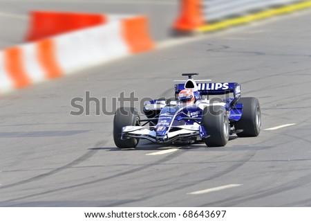 MOSCOW - JULY 19: Kazuki Nakajima of AT&T Williams at Bavaria Moscow City Racing 2009 at Kremlin embankment July 19, 2009 in Moscow - stock photo