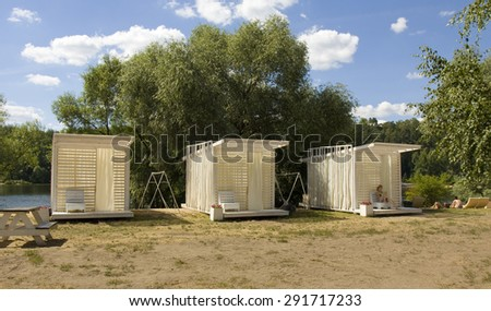 MOSCOW - JULY 20, 2014: people rest on beach in Serebryany bor (Silver forest) on Moskva-river, one of the most popular beaches of the city. - stock photo
