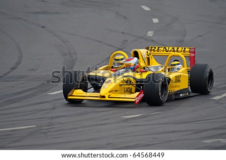 MOSCOW - JULY 18: Vitaly Petrov of Renault F1 Team at Bavaria Moscow City Racing 2010 at Kremlin embankment July 18, 2010 in Moscow - stock photo