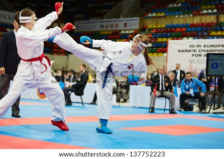 MOSCOW - JUN 9: Female fighter attacks opponent with her foot in fight at 10th Team Championship of Europe on karate at OC Luzhniki, Small sports arena, June 9, 2012, Moscow, Russia. - stock photo