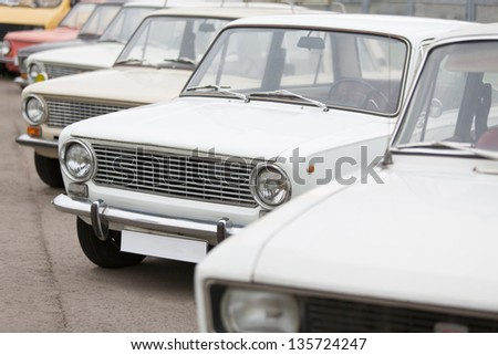 MOSCOW - JUN 8: Front view on the cars in Exhibition of Soviet vintage cars near the Ostankino TV tower on June 8, 2012 in Moscow, Russia. - stock photo