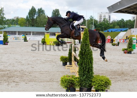 MOSCOW - JUN 9: International competitions in show jumping CSI3 Vivat, Russia in equestrian center Bitsa, June 9, 2012, Moscow, Russia. 178 sports pairs sent applications for participation. - stock photo