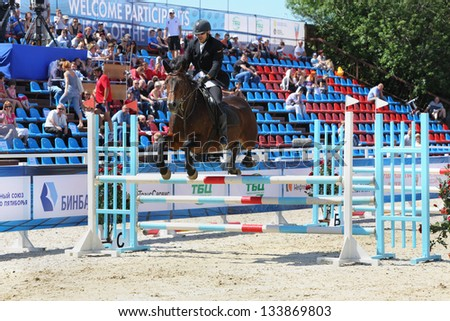 MOSCOW - JUN 17: Man participate in horse competitions on tournament on modern pentathlon - Kremlin Cup in horse-racing centre of CSKA, on Jun 17, 2012 in Moscow, Russia. - stock photo