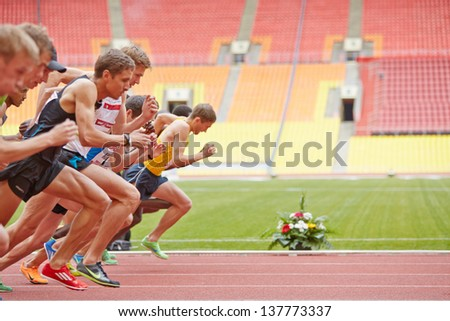 MOSCOW - JUN 11: Start of race at Grand Sports Arena of Luzhniki Olympic Complex during International athletics competitions IAAF World Challenge Moscow Challenge, June 11, 2012, Moscow, Russia. - stock photo
