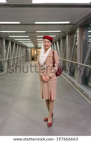 MOSCOW -JUNE 04: Emirates crew member on June 04, 2014 in Moscow, Russia. Emirates handles major part of passenger traffic and aircraft movements at the airport. - stock photo