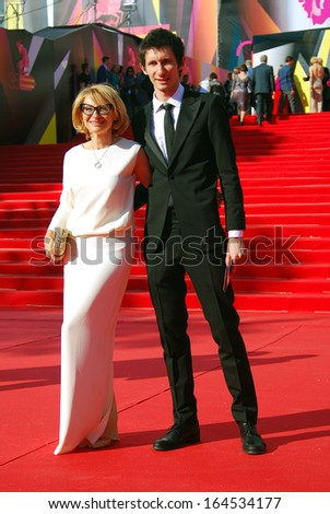 MOSCOW - JUNE 20: Fashion expert, tv-presenter Evelina Khromchenko with her son at XXXV Moscow International Film Festival red carpet opening ceremony. Taken on June 20, 2013 in Moscow, Russia. - stock photo
