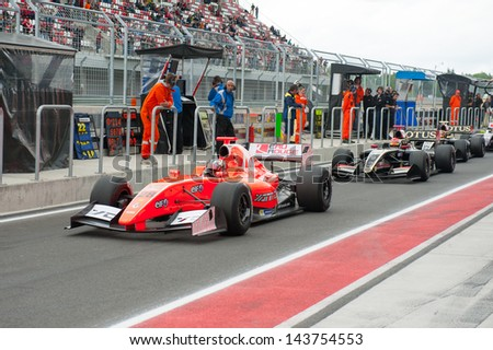 MOSCOW - JUNE 23: Formula cars ready for start at pit lane at World Series by Renault in Moscow Raceway on June 23, 2013 in Moscow - stock photo