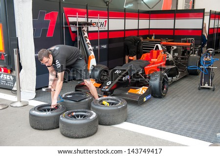 MOSCOW - JUNE 23: Mechanics prepare formula car for race at World Series by Renault in Moscow Raceway on June 23, 2013 in Moscow - stock photo