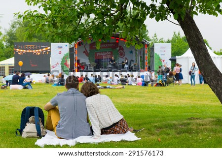 """MOSCOW - JUNE 20, 2015: People attend open-air concert on XII International Jazz Festival """"Usadba Jazz"""" in Tsaritsyno Park on June 20, 2015 in Moscow - stock photo"""