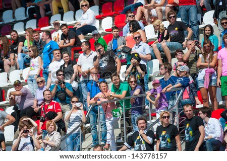 MOSCOW - JUNE 23: People attend World Series by Renault race in Moscow Raceway on June 23, 2013 in Moscow - stock photo