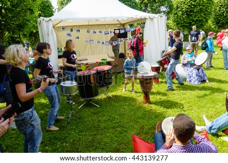"MOSCOW - JUNE 4: People drumming on International Jazz Festival ""Usadba Jazz"" in Archangelskoye Museum-Mansion on June 4, 2016 in Moscow - stock photo"
