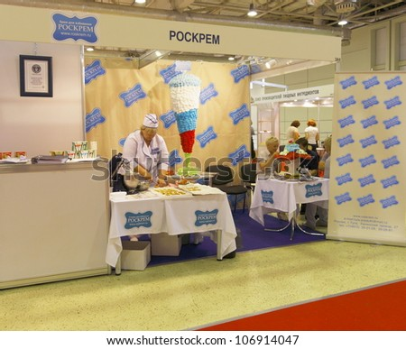 MOSCOW-JUNE 15:The stand of the russian company ROSKREM  producing vegetable cream for whipping the German technology at the international exhibition MODERN BAKERY 2012 on June 15, 2012 in Moscow - stock photo