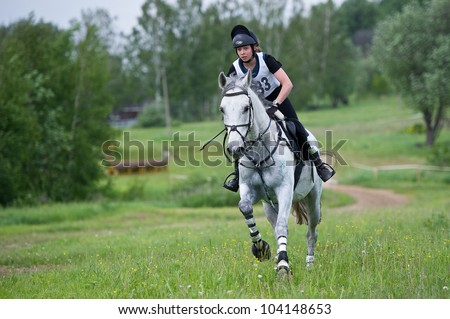 MOSCOW - JUNE 02: Unidentified rider on horse overcomes the obstacle at the International Eventing Competition CCI3*/2*/1* Russian Cup Eventing June 02, 2012 in Moscow, Russia - stock photo