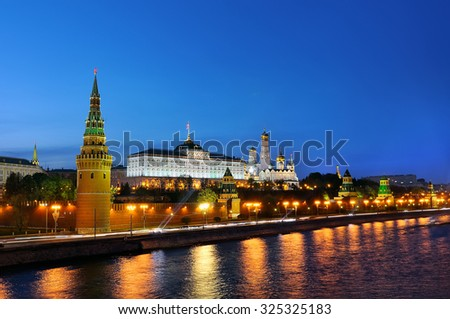 Moscow Kremlin and Moskva River at night. View of the Grand Kremlin Palace, towers of the Kremlin, Ivan the Great Bell Tower. - stock photo
