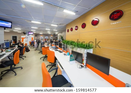 MOSCOW - MAR 5: Office buildings news agency RIA Novosti with different countries clock on the wall on March 5, 2013 in Moscow, Russia. - stock photo