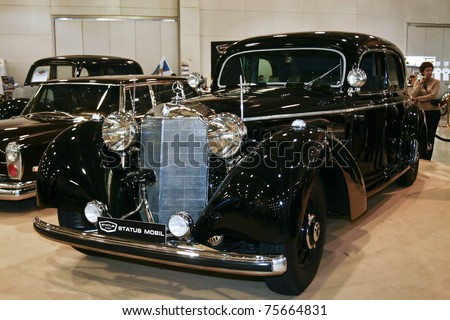 MOSCOW - MARCH 25: A 1942 Mercedes - Benz Typ 770 W150 on display at the Moscow Exhibition of technical antiques on March 25, 2011 in Moscow, Russia. - stock photo