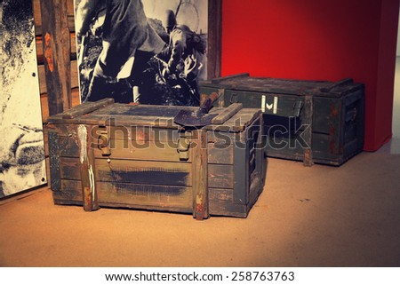 """Moscow - March 7: Moscow State Exhibition Hall """"New Manege"""", the exhibition """"Remember"""". Things WWII - Boxes of ammunition and sapper shovel, Russia, Moscow, March 7, 2015 - stock photo"""