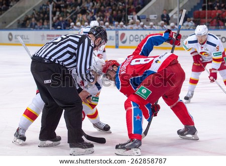 MOSCOW - MARCH 12: P. Virtanen (26) vs E. Korotkov (8) on faceoff during hockey game Yokerit vs CSKA on Russia KHL championship on March 12, 2015, in Moscow, Russia. CSKA won 3:2 - stock photo