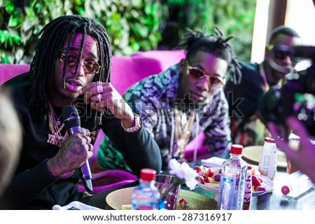 MOSCOW - 27, MARCH, 2015 : Rappers Soulja Boy and Migos (Quavo, Offset, Takeoff) at interview before concert in Russia - stock photo