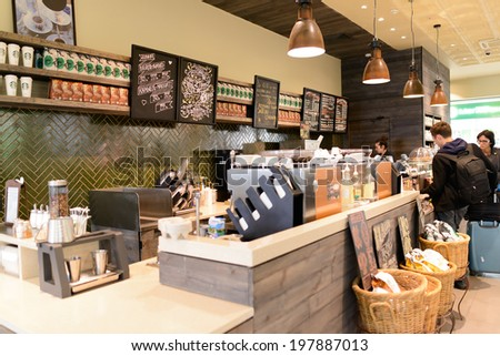 MOSCOW - MARCH 30: Starbucks cafe in Sheremetyevo airport on March 30, 2014 in Moscow. Starbucks Corporation is an American global coffee company and coffeehouse chain based in Seattle, Washington - stock photo