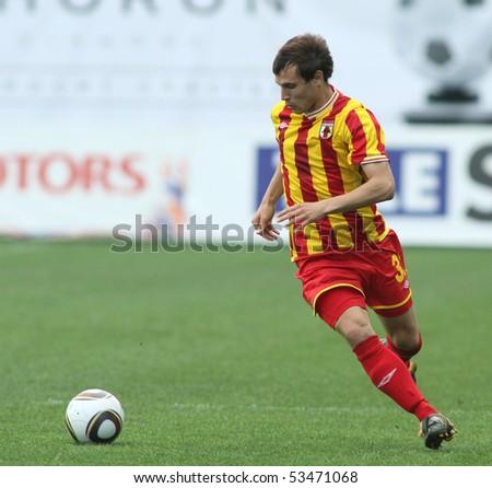 MOSCOW - MAY 15: Alania's midfielder Jeldar Nizamutdinov in a game of the 11th round of Russian Football Premier League - Dinamo Moscow vs. Alania Vladikavkaz - 2:0, May 15, 2010 in Moscow, Russia. - stock photo