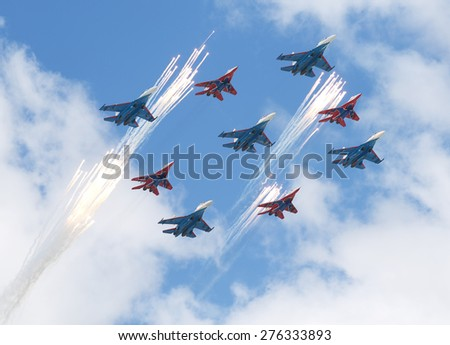 MOSCOW - MAY 7: Jet fighters do firework at last rehearsal of the parade dedicated to 70th anniversary of the victory in the Second World War in Red Square on May 7, 2015 in Moscow - stock photo