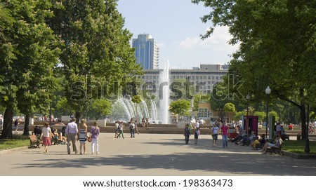 MOSCOW - MAY 23, 2014: moscovites and city visitors rest in Gorky park in summer. Park located in centre of the city has been founded in 1928, named by famous Russian writer Maxim Gorky in 1932. - stock photo