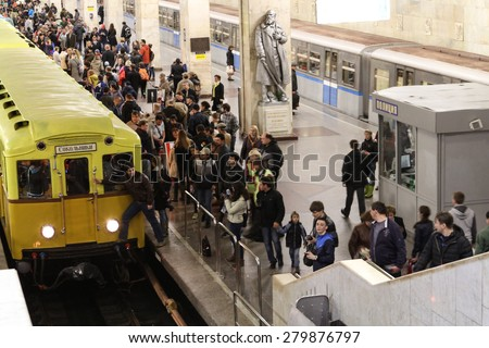 MOSCOW - MAY 5, 2015: People look vintage subway cars at the exhibition of retro-cars dedicated to the 80th anniversary of the Moscow Metro. Public-event - stock photo