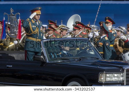 MOSCOW,07 MAY,2015: Russian defense Minister, Army General Sergei Shoigu rides in a limo at the Red Square in Moscow during the final rehearsal of the military parade to mark the Victory day - stock photo