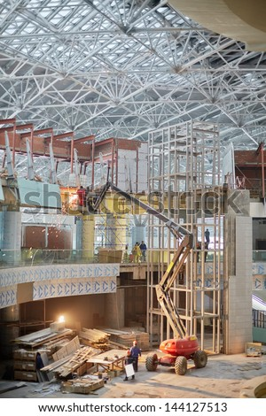 MOSCOW - NOV 29: Articulating boom at construction site of new terminal at Domodedovo Airport, November 29, 2012, Moscow, Russia. Terminal A has area of 96 thousand sq. m. - stock photo