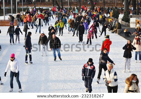 MOSCOW - NOV 22: People ice skating outdoors in the Gorky park on a lovely sunny day in Moscow on november 22.2014 RUSSIA  - stock photo