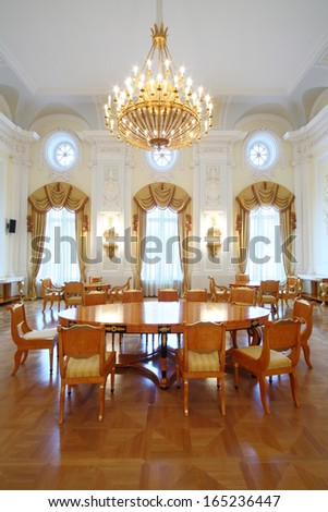 MOSCOW - OCT 10: A large round table in the luxurious living room in the Petroff Palace, on October 10, 2013 in Moscow, Russia.  - stock photo