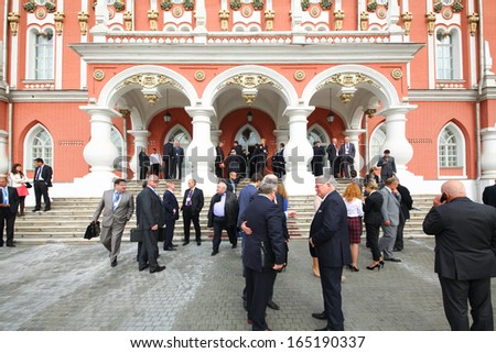 MOSCOW - OCT 10: Communication of congress delegates during a break on the International Congress of Industrialists and Entrepreneurs, on October 10, 2013 in Moscow, Russia. - stock photo