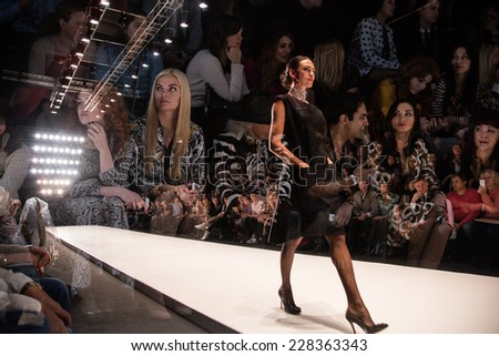 MOSCOW - OCTOBER 25: A model displays a creation by Russian designer Elena Souproun during Mercedes-Benz Fashion Week Russia on October 25, 2014 in Moscow, Russia. - stock photo