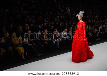 MOSCOW - OCTOBER 25: A model displays a creation by Russian designer Yulia Prokhorova during Mercedes-Benz Fashion Week Russia on October 25, 2014 in Moscow, Russia. - stock photo