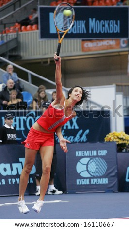 MOSCOW - OCTOBER 15: Anastasia Myskina , Russian tennis player, serves the ball at the Moscow's Kremlin Cup October 15, 2004 in Moscow, Russia. - stock photo