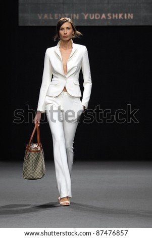 MOSCOW - OCTOBER 26: Model on podium during show of Valentin Yudashkin Collection as part of Fashion Week,, on October 26, 2011, Moscow, Russia - stock photo