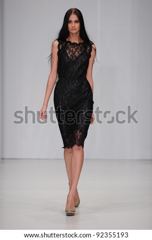 MOSCOW - OCTOBER 21: Model walking runway at the Von Vonni Collection for Spring/ Summer 2012 during Mercedes-Benz Fashion Week on October 21, 2011 in Moscow, Russia - stock photo