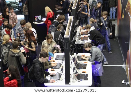 MOSCOW- OCTOBER 7:  People playing video games at the international exhibition of  the entertainment industry, Igromir on October 7, 2012 in Moscow - stock photo