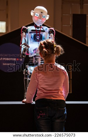 MOSCOW - OCTOBER 15: Robot and unknown guest during First Moscow International Forum - Culture. Look into the future on October 15, 2014 in Moscow, Russia. - stock photo