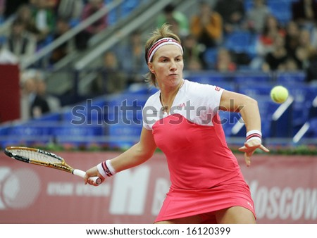 MOSCOW - OCTOBER 11: Svetlana Kuznetsova, Russian tennis player, returns the ball at the Moscow's Kremlin Cup October 11, 2006 in Moscow, Russia. - stock photo