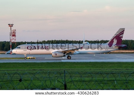 Moscow region, Domodedovo, Russia - August 18, 2013: Airbus A321 Qatar airways A7-ADW taxiing for take off and Boeing 747-400 Transaero airlines behind of him at Domodedovo international airport - stock photo